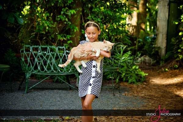 A party guests with one of Hemingway's famous cats